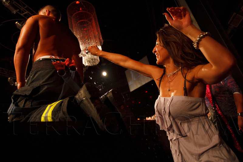 Nicole Kenyon is given the chance to participate by Robb Kvitek.  The 2013 Colorado Firefighter Calendar Auditions & Celebrity Judging Event at Exdo Event Center in Denver, Colorado, on Friday, May 11, 2012.<br /> Photo Steve Peterson