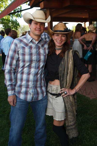 Craig Arcand and Maryvonne Tomkins.  The Barn Party, benefitting Denver Active 20-30 Children's Foundation, at the Polo Reserve Development in Littleton, Colorado, on Saturday, May 19, 2012.<br /> Photo Steve Peterson