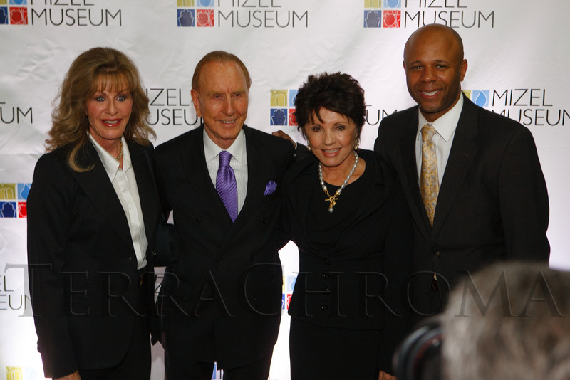 Kalleen Malone, Glenn Jones, Dianne Eddolls, and Ryan Frazier.  Mizel Museum 22nd Annual Gala Dinner, honoring Glenn R. Jones, at Wings Over the Rockies Air & Space Museum in Denver, Colorado, on Wednesday, May 23, 2012.<br /> Photo Steve Peterson
