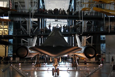 The Lockheed SR-71 Blackbird.  In the background, crowds are among the first to see Discovery on display.