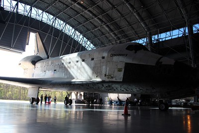 Discovery rolls into the James S. McDonnell Space Hangar at the Smithsonian National Air and Space Museum's Steven F. Udvar-Hazy Center