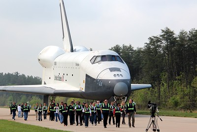 Workers from United Space Alliance walk from Enterprise to Discovery