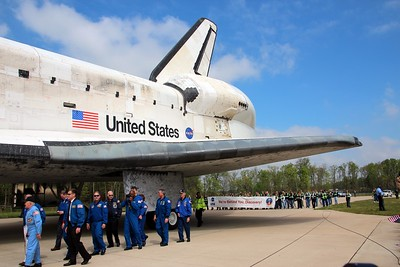 Former commanders and crew escort Discovery, followed by workers from United Space Alliance