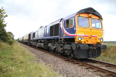 66723 on the rear of 55002, Station Road crossing, Ailsworth.