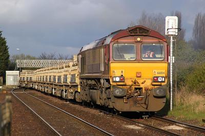 66104 TnT 66057 1840/6G16 Whitemoor-Blotoft passes Norwood Road crossing.