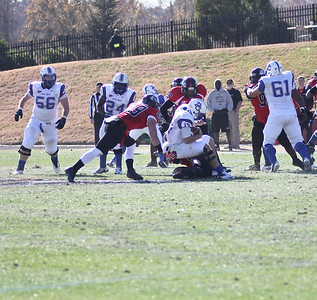 Brian Wittenberger (49), and Bradley Taylor (47) make a tackle for GWU