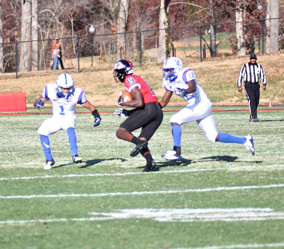 Kenny Cook (19) runs the ball for an attempted Bulldog first down.