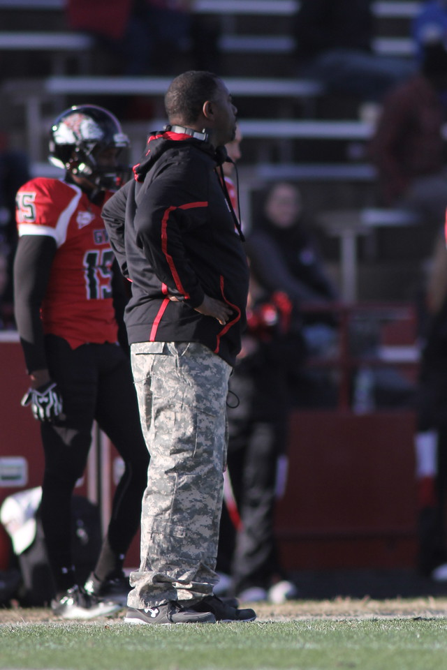 Coach Ron Dickerson Jr and the rest of the coaches and field personal sports Army Camouflage in honor of Military Appreciation Day