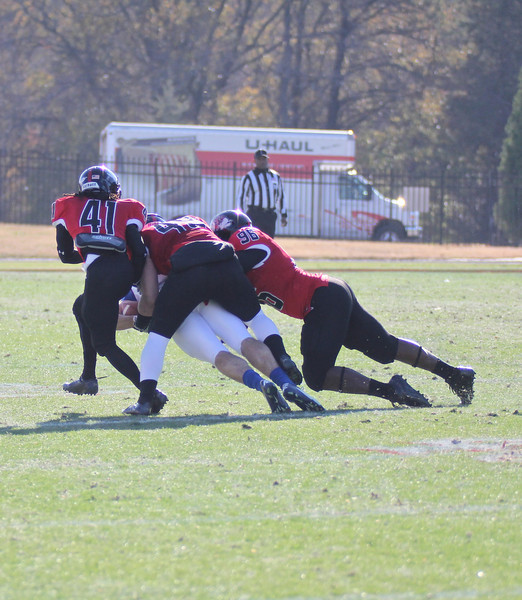 Brian Wittenberger (49) tackles PC's player