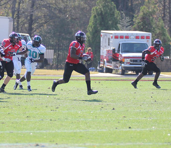 Kenny Little (6) carries the ball down the field