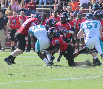 Brian Wittenberger (49) Chad Geter (38) Tanner Burch (55) tackles Coastal