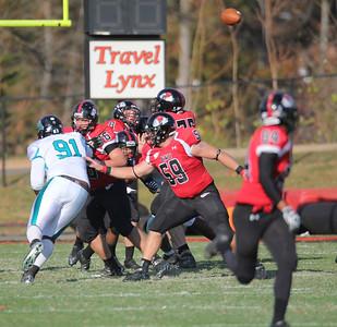 GWU's offense blocks as Beatty (8) throws the ball to a team mate