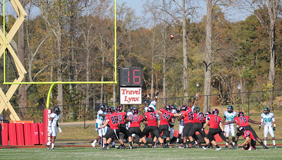 Trever Austin (1) kicks a field goal for GWU