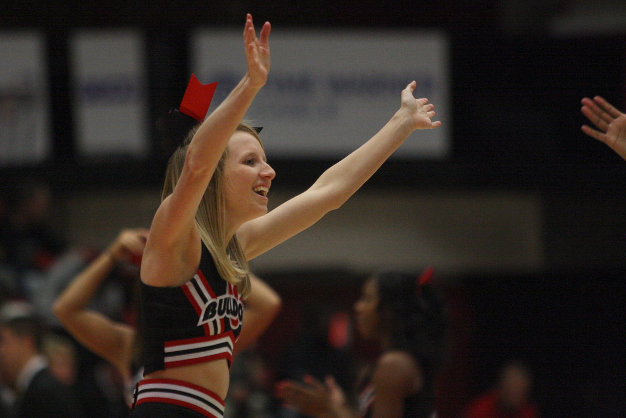Cheerleader, Cameron Puckett, cheers on the Runnin' Bulldogs during a time out.