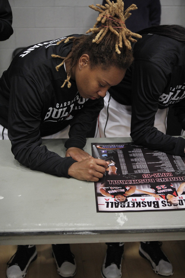 The Women's Basketball team signed autographs on posters for students and local fans during half time.