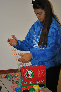 Students help pack operation christmas child boxs at the Joyful Hands packing party.