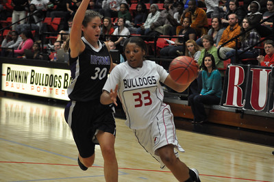 Jasmine Dale drives to teh basket against Lipscomb University, Friday November 9, 2012 in the LYCC.