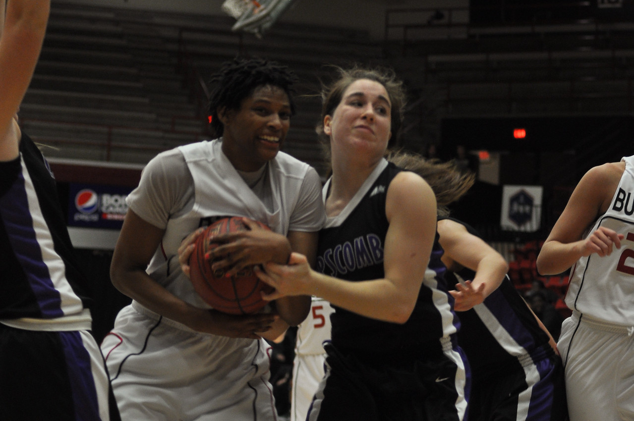 Jessica Heilig gains a jumpball from Lipscomb University, Friday November 9, 2012 in the LYCC.