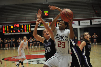Jessica Heilig drives to the basket against Lipscomb University, Friday November 9, 2012 in the LYCC.