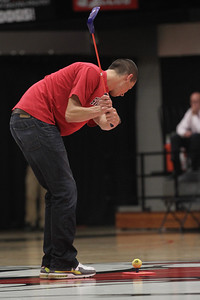 Two Gardner-Webb students, Jacob McConnell and Brandon Smith, participated in a during time out game where one hits a 'golf ball' toward their team mate to make the target.