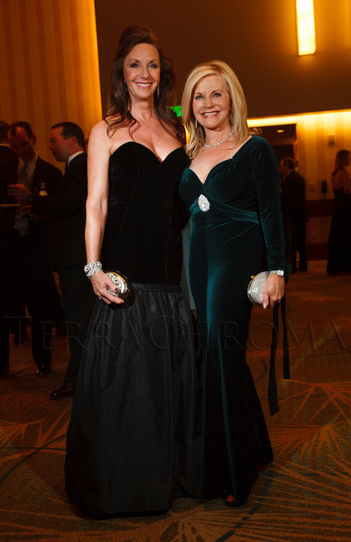 "Debra McKenney (Carmen Marc Valvo, holding a Mary Norton minaudière) and Nancy Sevo (Marc Bouwer, holding a Judith Leiber minaudière).  ""Legacy Gala 2012,"" benefiting Children's Hospital Colorado Foundation, at the Hyatt Regency Denver at the Colorado Convention Center in Denver, Colorado, on Saturday, Nov. 10, 2012.<br /> Photo Steve Peterson"