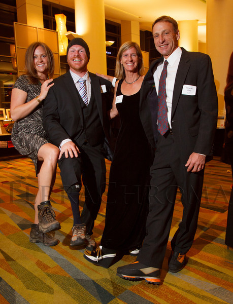 With Soldiers to Summits:  Lindsey and Chad Stone, Becky Hall, and Charlie Mace.  Colorado Outward Bound School Black Tie and Tennis Shoe Bucket List Gala, celebrating the COBS 50th anniversary, at the Hyatt Regency Denver at the Colorado Convention Center in Denver, Colorado, on Wednesday, Nov. 14, 2012.<br /> Photo Steve Peterson