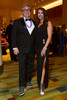 Erik Dyce in Pumas and Karen Meyer in Rock & Candy shoes, Don Castor dress with a Swarovski brooch.  Colorado Outward Bound School Black Tie and Tennis Shoe Bucket List Gala, celebrating the COBS 50th anniversary, at the Hyatt Regency Denver at the Colorado Convention Center in Denver, Colorado, on Wednesday, Nov. 14, 2012.<br /> Photo Steve Peterson