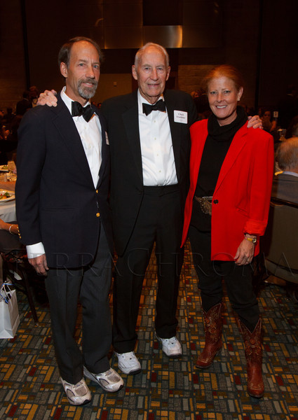 Chuck Froelicher (center, a co-founder of COBS) with his son, Franz (left) and Diane Gates Wallach (daughter of co-founder Charlie Gates).  Colorado Outward Bound School Black Tie and Tennis Shoe Bucket List Gala, celebrating the COBS 50th anniversary, at the Hyatt Regency Denver at the Colorado Convention Center in Denver, Colorado, on Wednesday, Nov. 14, 2012.<br /> Photo Steve Peterson