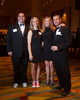Bryan and Jill Sulser with Barrie and Vince Ciulla.  Colorado Outward Bound School Black Tie and Tennis Shoe Bucket List Gala, celebrating the COBS 50th anniversary, at the Hyatt Regency Denver at the Colorado Convention Center in Denver, Colorado, on Wednesday, Nov. 14, 2012.<br /> Photo Steve Peterson