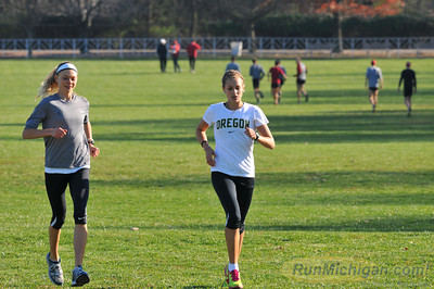 A pair of University of Oregon runners get familiar with the course, the day before the race at the 2012 NCAA Division One Cross Country Championships in Louisville, KY. (RunMichigan.com/Dave McCauley)