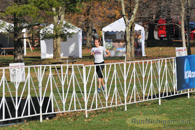 An athlete gets a feel for the finish area the day before the 2012 NCAA Division One Cross Country Championships being held on November 17 in Louisville, KY. (RunMichigan.com/Dave McCauley)