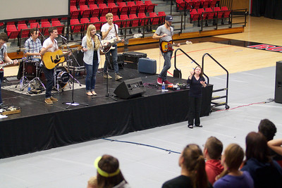 The worship band leads a song during Fields of Faith.