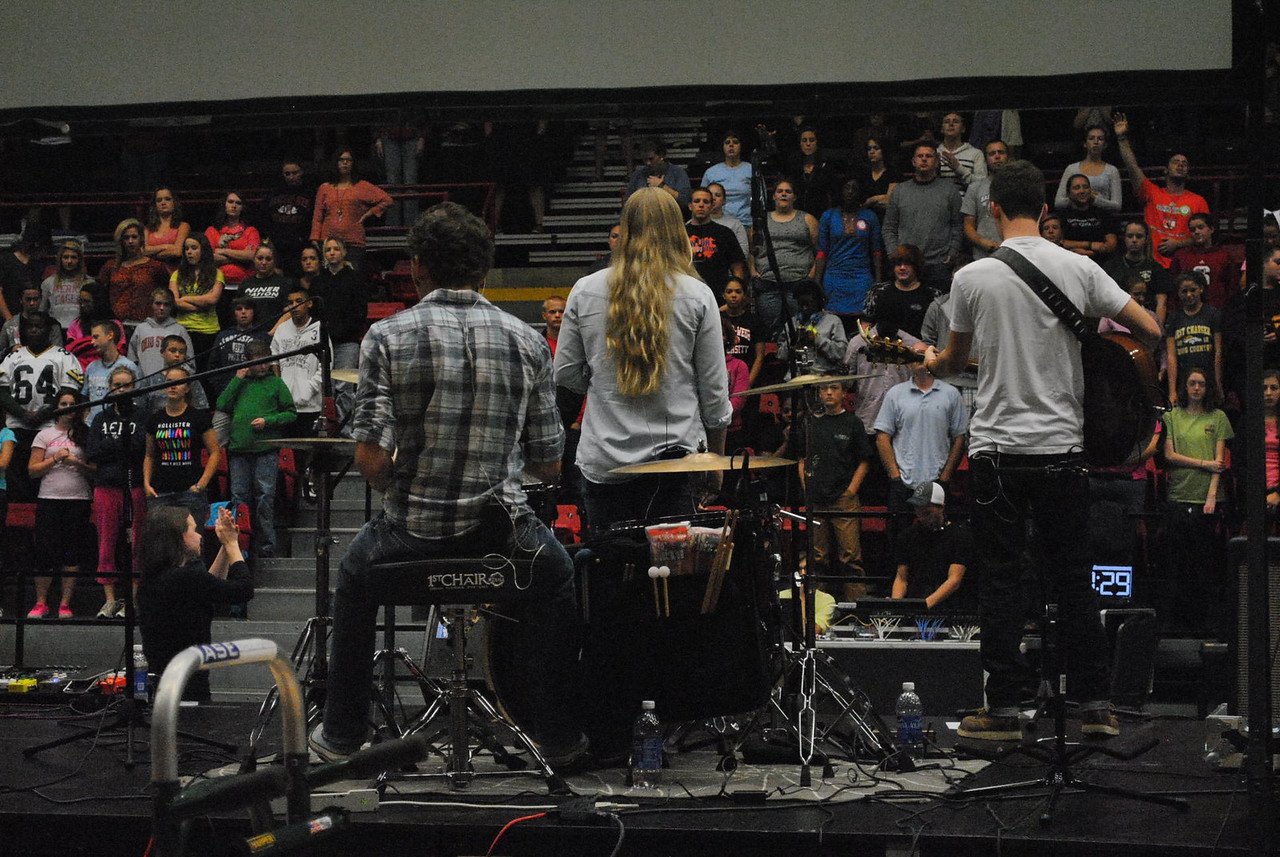 The band leading worship at Fields of Faith.