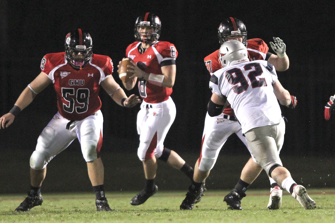 Austin Sargent (59) prepares to block for Lucas Beatty (8)