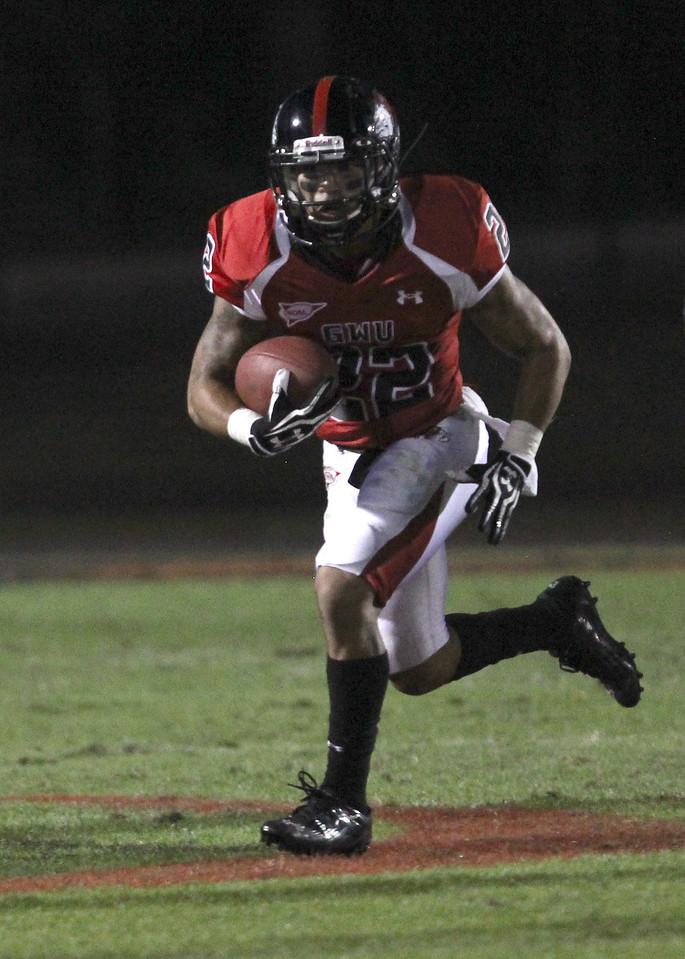 J.J. Hubbard (22) runs the ball