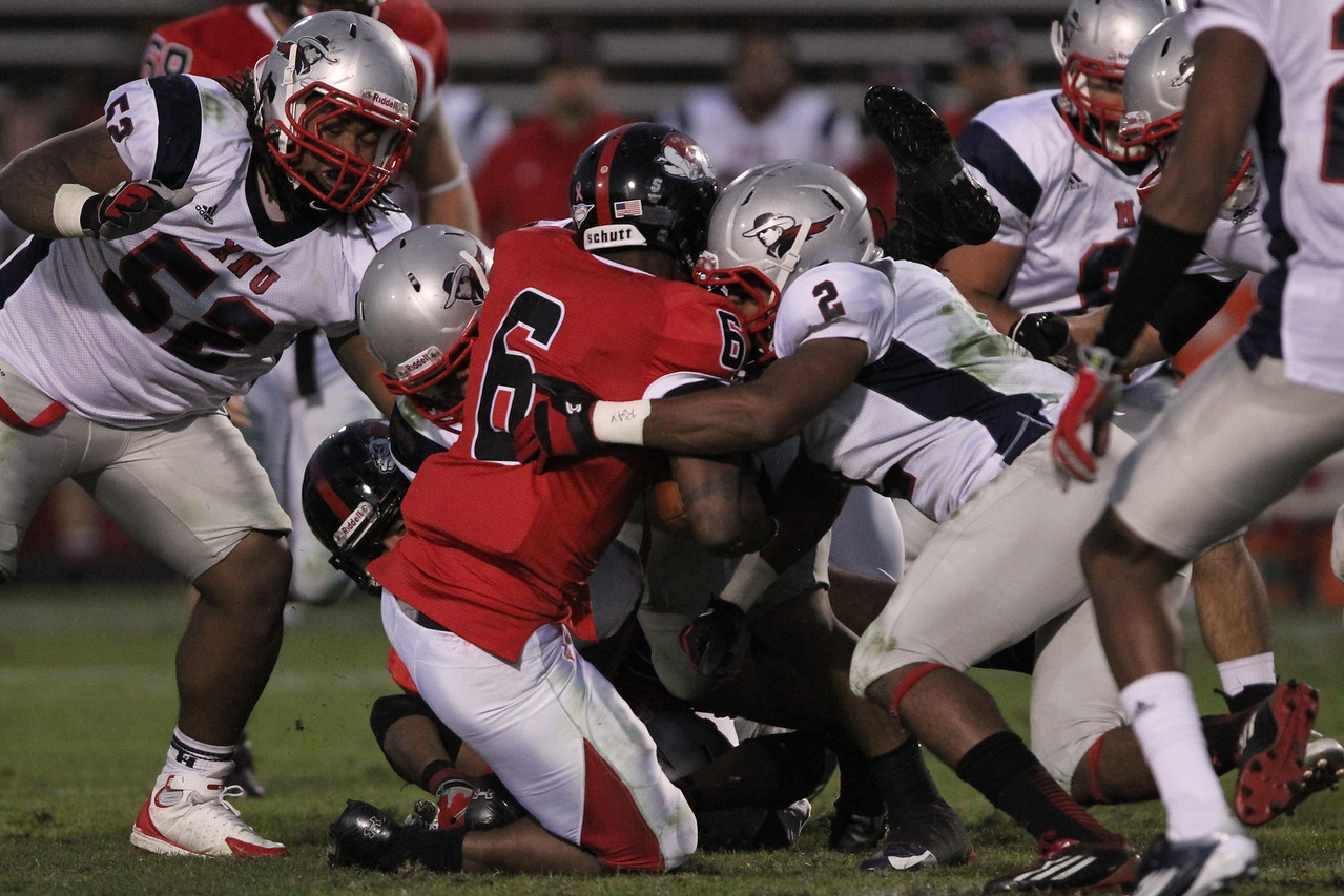 Kenny Little (6) fights against a tackle