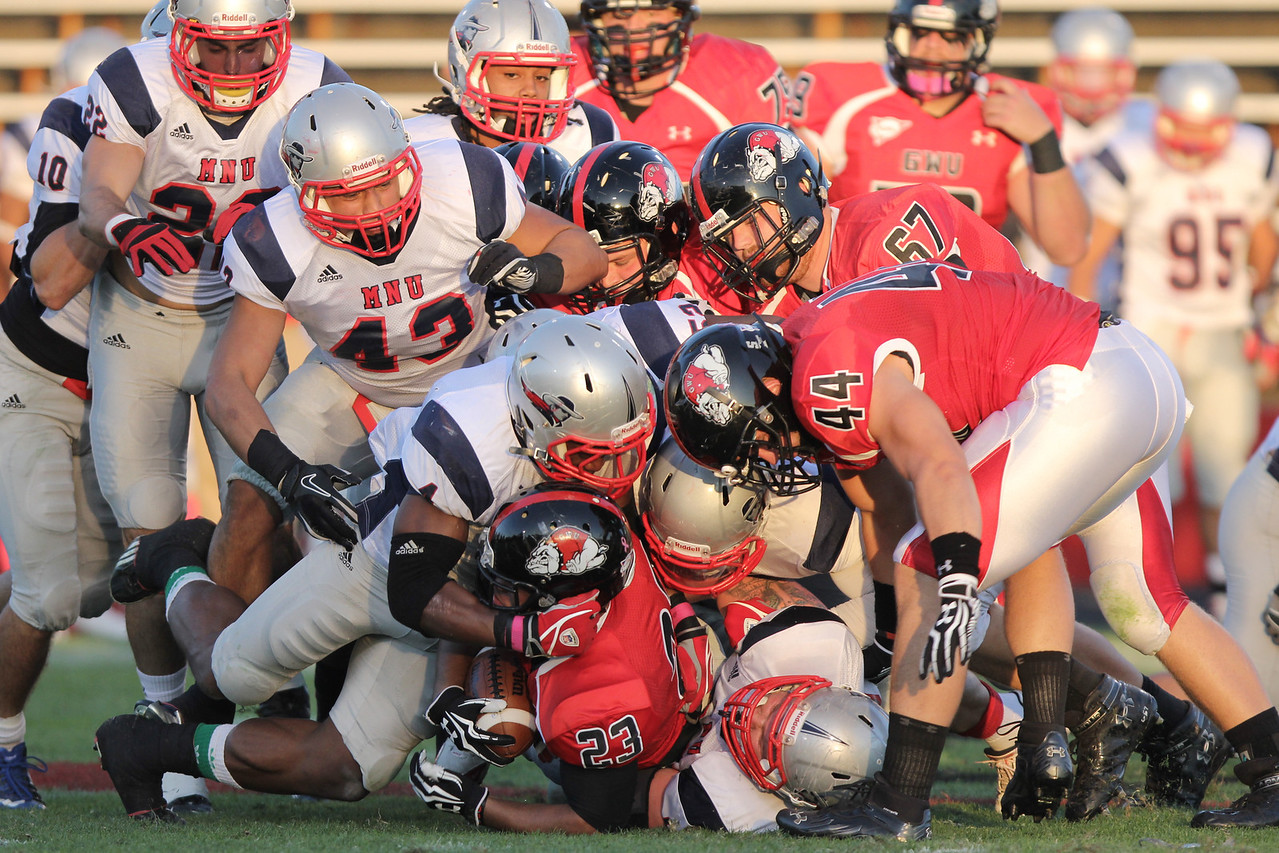 Juanne Blount (23) gets tackled by MNU's defense