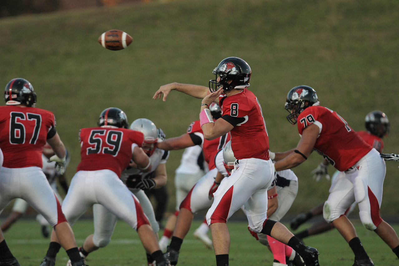 Lucas Beatty (8) throws the ball as the offensive line blocks for him