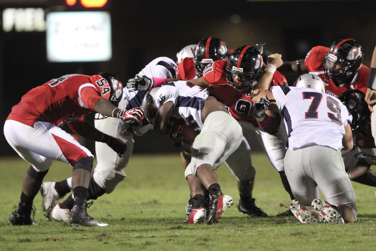 Maurice Dickson (54) goes head first into the tackle on MNU