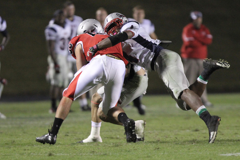 Seth Cranfll (86) fights against MNU in order to gain more yards