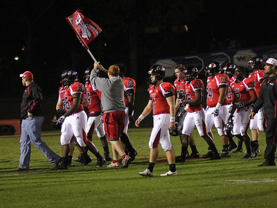 Jacob McConnell runs on the field to celebrate a GWU win.