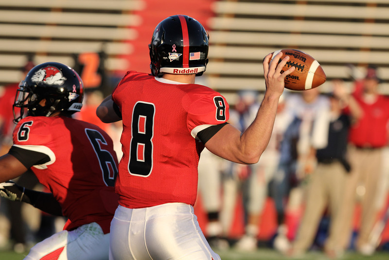 Lucas Beatty (8) throws the ball down the field