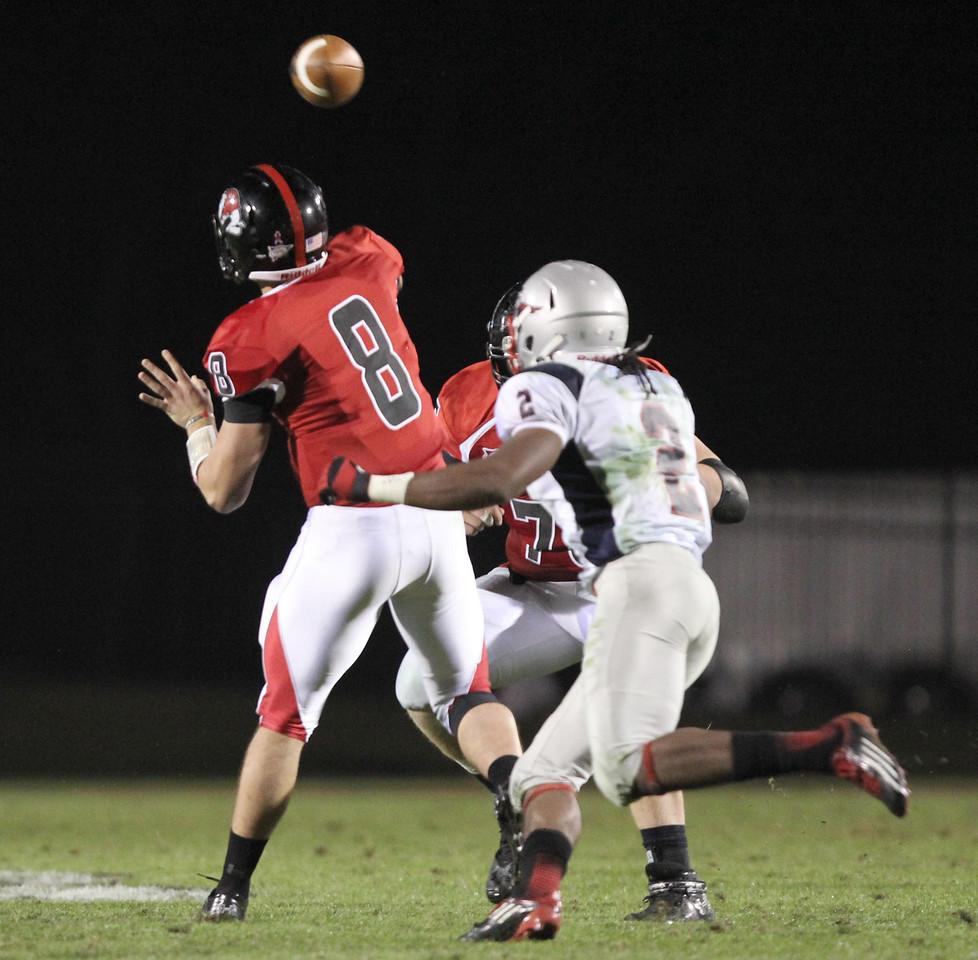 Lucas Beatty (8) throws the ball
