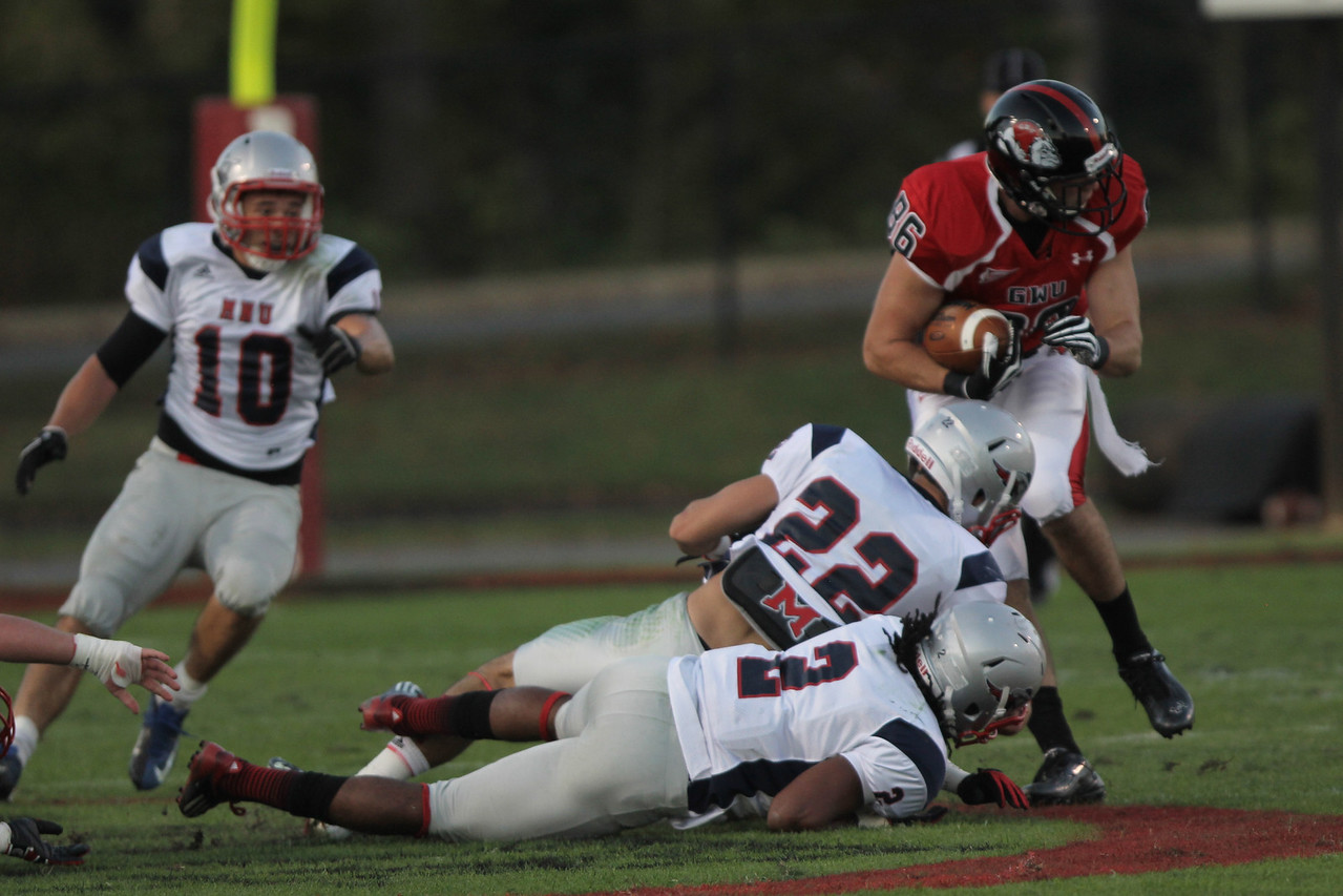 Seth Cranfill (86) stays up and pushes through a tackle