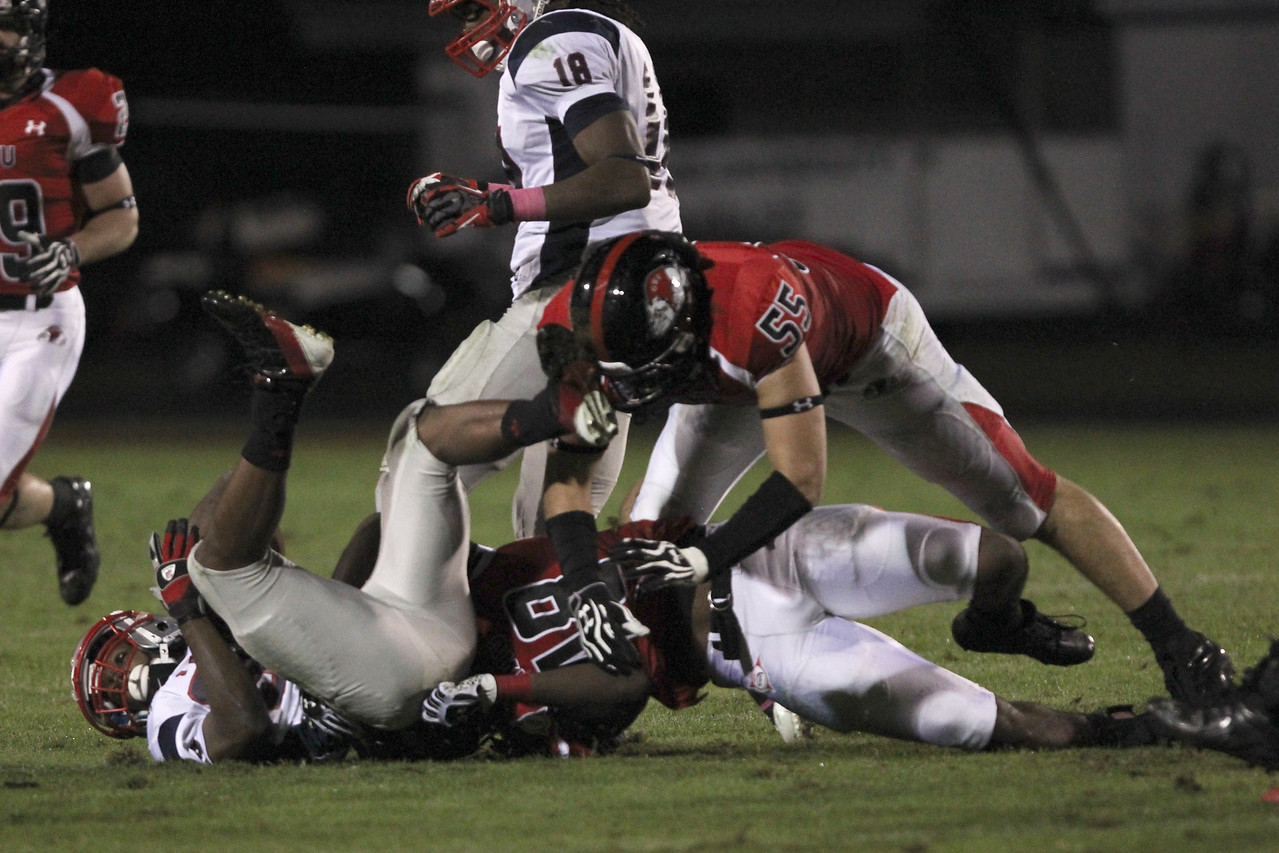Azizz Higgins (48) and Tanner Burch (55) get a tackle on MNU