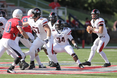 The Runnin' Bulldogs block for quarterback Lucas Beatty (8) while he looks for an open player