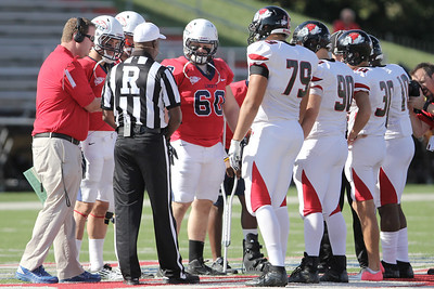 The starting players on the field for the coin toss. Steve Demilio (79), Dylan Taylor (90), Bo Lindsay (30) and Chris James (10)