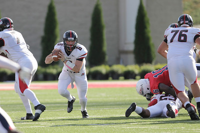 Lucas Beatty (8) scrambles before throwing the ball