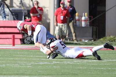 Tanner Burch (55) tackles Liberty's player