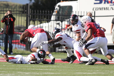Drew White (28) and Azziz Higgins (48) attempt for the tackle on Liberty